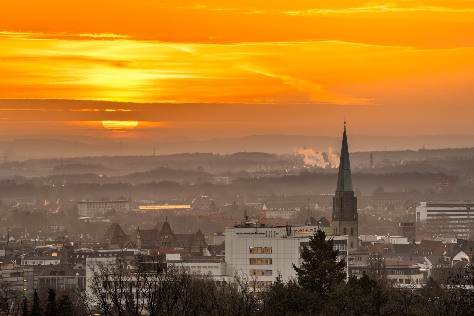 Sunrise over the city centre on 20 February 2021 (Bielefeld, Germany).