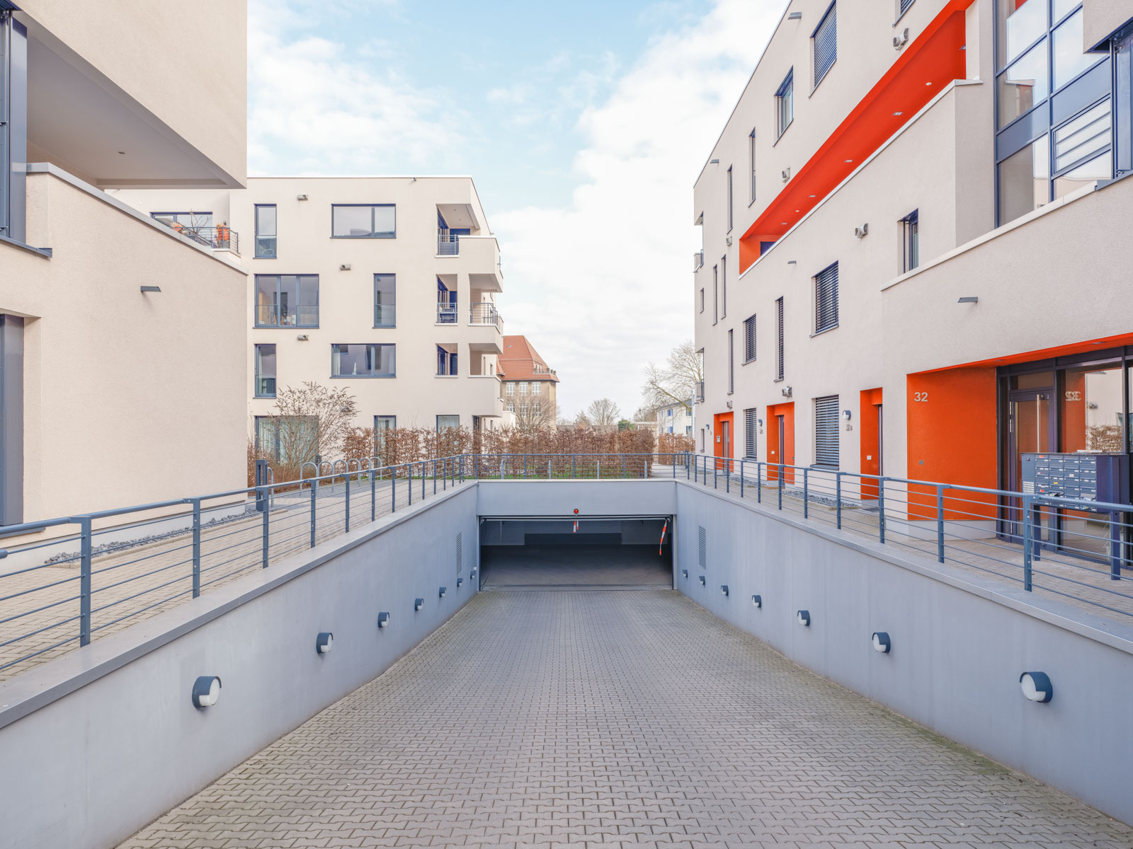 New housing estate with garage entrance on 'Walther-Rathenau-Straße' in March 2021 (Bielefeld, Germany).