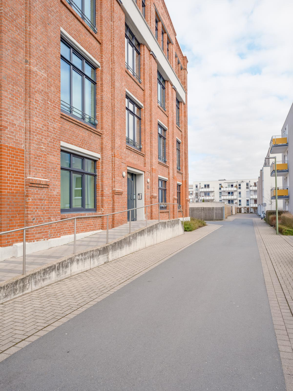 Side street in a newly built residential area in March 2021 (Bielefeld, Germany).