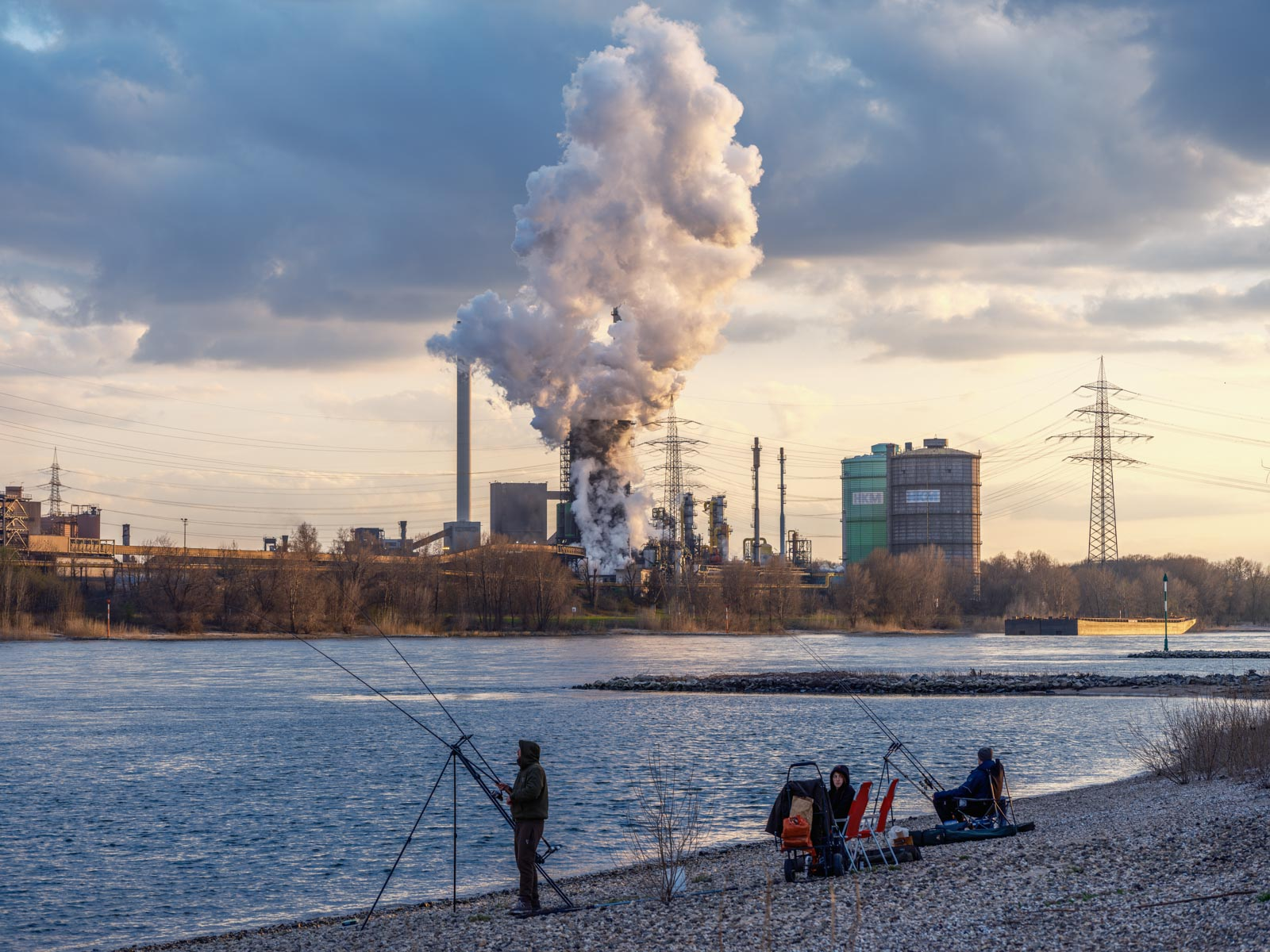 Anglers on the Rhine in Duisburg-Rheinhausen opposite the Krupp Mannesmann steelworks in March 2021 (Germany).