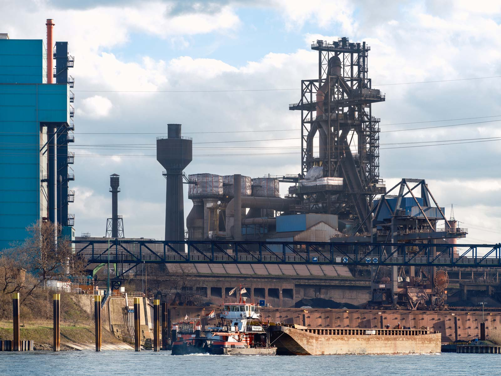 Port and blast furnace at Krupp Mannesmann steelworks (HKM) in Duisburg on the Rhine in the late afternoon in March 2021 (Germany).
